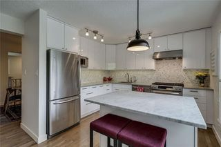 Photo 7: 13 POINT MCKAY Court NW in Calgary: Point McKay Row/Townhouse for sale : MLS®# C4299919