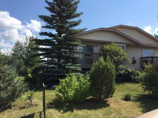 Photo 1: 2 West Aarsby Road: Cochrane Semi Detached for sale : MLS®# A1017506