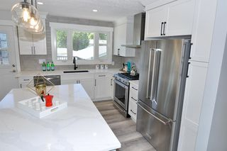 Photo 5: 235 99 Avenue SE in Calgary: Willow Park Detached for sale : MLS®# A1016375