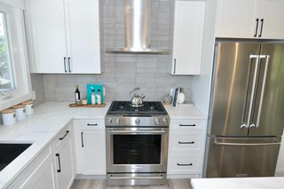 Photo 6: 235 99 Avenue SE in Calgary: Willow Park Detached for sale : MLS®# A1016375
