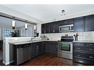 Photo 6: 114 ELGIN MEADOWS Gardens SE in CALGARY: McKenzie Towne Residential Attached for sale (Calgary)  : MLS®# C3542385