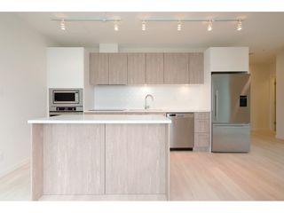 """Photo 3: 2204 691 NORTH Road in Coquitlam: Coquitlam West Condo for sale in """"BURUITLAM CAPITAL"""" : MLS®# R2398383"""