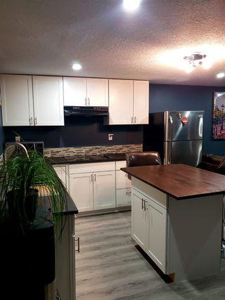 Photo 2: 11412 129 Avenue in Edmonton: Zone 01 House for sale : MLS®# E4222630