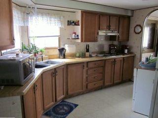 "Photo 2: 77 7850 KING GEORGE Boulevard in Surrey: East Newton Manufactured Home for sale in ""Bear Creek Glen"" : MLS®# F1317866"