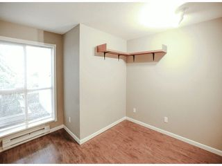 "Photo 12: 114 7505 138TH Street in Surrey: East Newton Condo for sale in ""Midtown Villa"" : MLS®# F1417804"