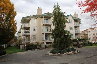 Photo 1: 404 20453 53 AVENUE in Langley: Langley City Condo for sale : MLS®# R2120225