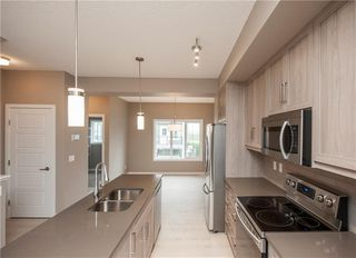 Photo 7: 163 Nolancrest CM NW in Calgary: Nolan Hill House for sale : MLS®# C4190728