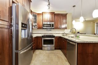 "Photo 2: 412 2860 TRETHEWEY Street in Abbotsford: Central Abbotsford Condo for sale in ""La Galleria"" : MLS®# R2442032"