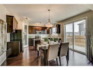 Photo 12: 635 Windbrook Heights SW in Airdrie: Windsong WDS House for sale : MLS®# C4070475