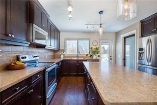 Photo 9: 734 Stonehaven Drive: Carstairs Detached for sale : MLS®# C4270012
