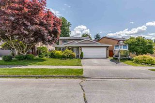 Main Photo: 1060 LOMBARDY Drive in Port Coquitlam: Lincoln Park PQ House for sale : MLS®# R2462097