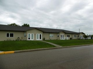 Photo 1: 2 5414 51 Street in Rimbey: NONE Residential for sale : MLS®# A1007458