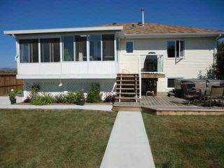 Photo 13: 119 QUIGLEY Drive: Cochrane Residential Detached Single Family for sale : MLS®# C3536407