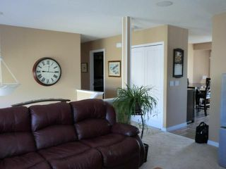 Photo 8: 119 QUIGLEY Drive: Cochrane Residential Detached Single Family for sale : MLS®# C3536407