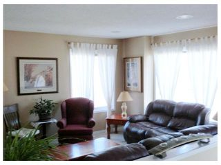 Photo 7: 119 QUIGLEY Drive: Cochrane Residential Detached Single Family for sale : MLS®# C3536407