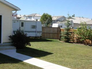 Photo 19: 119 QUIGLEY Drive: Cochrane Residential Detached Single Family for sale : MLS®# C3536407