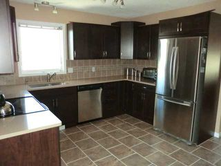 Photo 3: 119 QUIGLEY Drive: Cochrane Residential Detached Single Family for sale : MLS®# C3536407