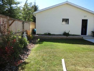 Photo 18: 119 QUIGLEY Drive: Cochrane Residential Detached Single Family for sale : MLS®# C3536407