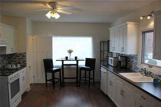 Photo 4: 1014 Nanton Avenue: Crossfield Detached for sale : MLS®# C4281376