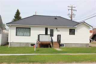 Photo 1: 1014 Nanton Avenue: Crossfield Detached for sale : MLS®# C4281376