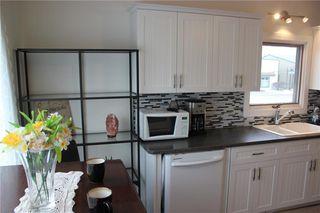 Photo 9: 1014 Nanton Avenue: Crossfield Detached for sale : MLS®# C4281376