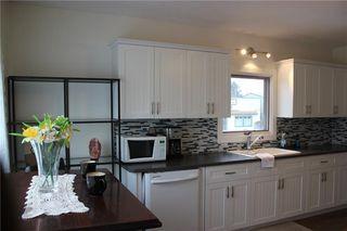 Photo 3: 1014 Nanton Avenue: Crossfield Detached for sale : MLS®# C4281376