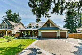 Photo 1: 4076 207 Street in Langley: Brookswood Langley House for sale : MLS®# R2476292