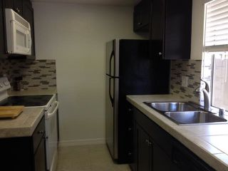 Photo 2: RANCHO SAN DIEGO Townhome for sale : 2 bedrooms : 1536 Gustavo #C in El Cajon