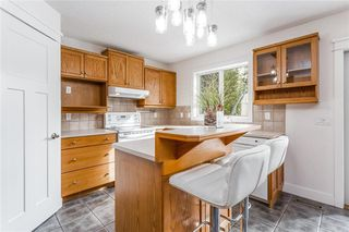 Photo 5: 438 DOUGLAS WOODS ME SE in Calgary: Douglasdale/Glen House for sale : MLS®# C4210900