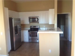 Photo 2: CARMEL VALLEY Condo for sale : 2 bedrooms : 3824 Elijah Court #101 in San Diego