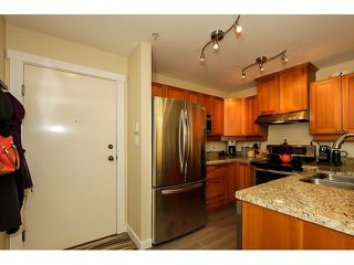 Photo 4: # 110 1432 PARKWAY BV in Coquitlam: Westwood Plateau Condo for sale : MLS®# V1070614