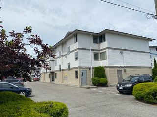 "Photo 1: 106 7435 SHAW Avenue in Sardis: Sardis East Vedder Rd Condo for sale in ""Timberland Apartments"" : MLS®# R2467403"