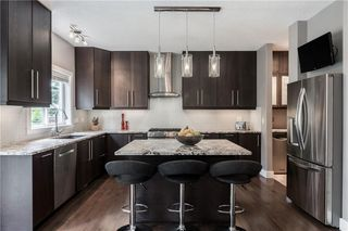 Main Photo: 25 39 STRATHLEA Common SW in Calgary: Strathcona Park Semi Detached for sale : MLS®# C4305635