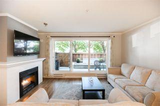 """Photo 1: 103 1570 PRAIRIE Avenue in Port Coquitlam: Glenwood PQ Condo for sale in """"VIOLAS"""" : MLS®# R2498060"""