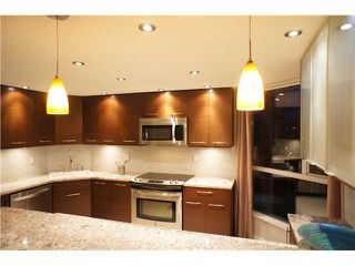"""Photo 2: 301 1185 QUAYSIDE Drive in New Westminster: Quay Condo for sale in """"RIVIERA MANSIONS"""" : MLS®# V1000019"""