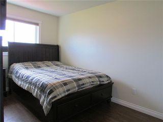 """Photo 13: 10409 109TH Street in Fort St. John: Fort St. John - City NE 1/2 Duplex for sale in """"SUNSET RIDGE"""" (Fort St. John (Zone 60))  : MLS®# N229918"""