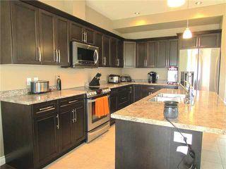 """Photo 6: 10409 109TH Street in Fort St. John: Fort St. John - City NE House 1/2 Duplex for sale in """"SUNSET RIDGE"""" (Fort St. John (Zone 60))  : MLS®# N229918"""
