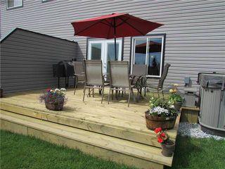 """Photo 4: 10409 109TH Street in Fort St. John: Fort St. John - City NE House 1/2 Duplex for sale in """"SUNSET RIDGE"""" (Fort St. John (Zone 60))  : MLS®# N229918"""
