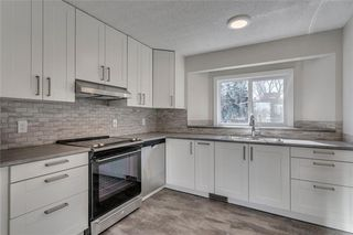 Photo 2: 11137 SACRAMENTO Drive SW in Calgary: Southwood Semi Detached for sale : MLS®# C4289104