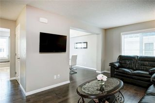 Photo 2: 158 WINDSTONE Mews SW: Airdrie Row/Townhouse for sale : MLS®# C4295967