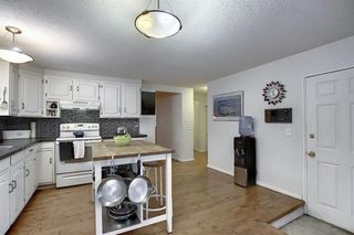 Photo 9: 239 Silvercreek Way NW in Calgary: Silver Springs Detached for sale : MLS®# A1040250