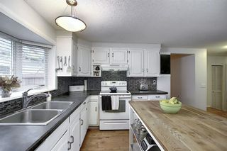 Photo 10: 239 Silvercreek Way NW in Calgary: Silver Springs Detached for sale : MLS®# A1040250