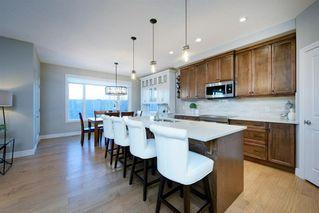 Photo 7: 191 Aspen Acres Manor SW in Calgary: Aspen Woods Detached for sale : MLS®# A1048705