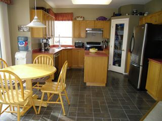"Photo 12: 18436 65TH Avenue in Surrey: Cloverdale BC House for sale in ""Clover Valley Station"" (Cloverdale)  : MLS®# F1302703"