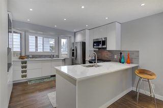 Photo 1: 11215 35 AV NW in Edmonton: Zone 16 House for sale : MLS®# E4138404