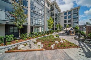 "Photo 1: 408 5638 201A Street in Langley: Langley City Condo for sale in ""The Civic by Creada Developments"" : MLS®# R2408567"