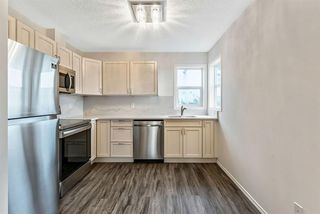 Photo 5: 16 200 Hidden Hills Terrace NW in Calgary: Hidden Valley Row/Townhouse for sale : MLS®# A1042995