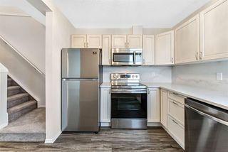 Photo 4: 16 200 Hidden Hills Terrace NW in Calgary: Hidden Valley Row/Townhouse for sale : MLS®# A1042995