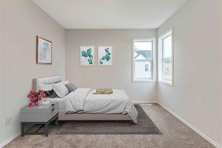 Photo 10: 16 200 Hidden Hills Terrace NW in Calgary: Hidden Valley Row/Townhouse for sale : MLS®# A1042995