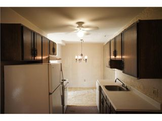 """Photo 2: 107 3901 CARRIGAN Court in Burnaby: Government Road Condo for sale in """"LOUGHEED ESTATES"""" (Burnaby North)  : MLS®# V971781"""